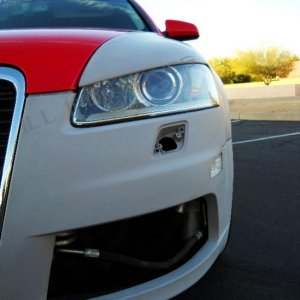 Sam Kimmel Audi a6 c6 k6 fenders ill industries misano red pearl widebody style with intergrated eyelids and vents.